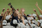 Tampa Bay Rays hold the American League championship trophy following their victory against the Houston Astros in Game 7 of a baseball American League Championship Series, Saturday, Oct. 17, 2020, in San Diego. The Rays defeated the Astros 4-2 to win the series 4-3 games. (AP Photo/Gregory Bull)