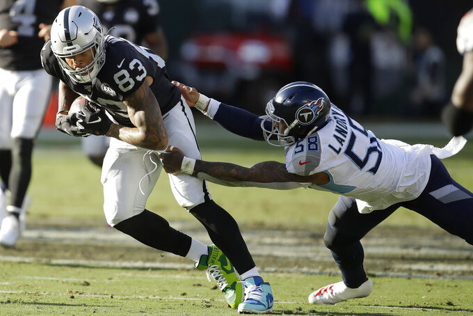 FILE - In this Dec. 8, 2019, file photo, Oakland Raiders tight end Darren Waller (83) runs past Tennessee Titans linebacker Harold Landry (58) during the first half of an NFL football game in Oakland, Calif. Waller has become many things since joining the Raiders organization. A well-rounded tight end, a leader on and off the field, an inspiration to his teammates and fans, and now, a bargain.  (AP Photo/Ben Margot, File)