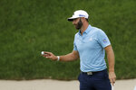 Dustin Johnson reacts after sinking his putt on the 18th green to win the final round of the Travelers Championship golf tournament at TPC River Highlands, Sunday, June 28, 2020, in Cromwell, Conn. (AP Photo/Frank Franklin II)