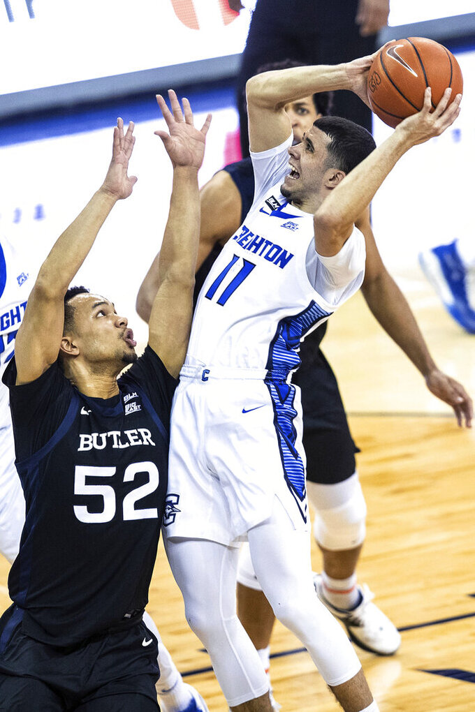 Creighton's Marcus Zegarowski shoots over Butler's Jair Bolden during the first half of an NCAA college basketball game Saturday, March 6, 2021, in Omaha, Neb. (Chris Machian/Omaha World-Herald via AP)