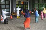 COVID-19 patients exercise at the Patriot Candrabhaga stadium which was recently turned into an isolation center amid the coronavirus outbreak in Bekasi on the outskirts of Jakarta, Indonesia,Wednesday, Jan. 6, 2021. (AP Photo/Achmad Ibrahim)