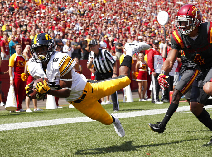 FILE - In this Sept. 9, 2017, file photo, Iowa wide receiver Ihmir Smith-Marsette (6) catches a 15-yard touchdown pass ahead of Iowa State defensive back Evrett Edwards, right, during the second half of an NCAA college football game, in Ames, Iowa. Iowa knows it'll have to revamp its tight-end focused offense in 2019 after losing two of the best in school history to the NFL. Brandon Smith and Imhir Smith-Marsette will likely be the major benefactors of T.J. Hockenson and Noah Fant's departures. (AP Photo/Charlie Neibergall, File)