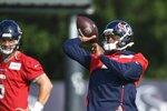 Texans quarterback Deshaun Watson (4) throws the ball during NFL football practice Saturday, July 31, 2021, in Houston. (AP Photo/Justin Rex)
