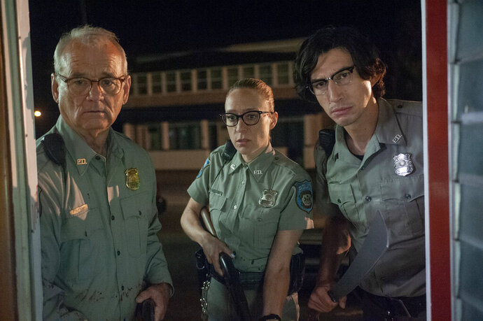 This undated image provided by Focus Features from left to right, shows Bill Murray, Chloë Sevigny and Adam Driver in a scene from writer/director Jim Jarmusch's