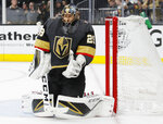 Vegas Golden Knights goaltender Marc-Andre Fleury (29) makes a save against the San Jose Sharks during the third period in Game 6 of a first-round NHL hockey playoff series Sunday, April 21, 2019, in Las Vegas. (AP Photo/John Locher)