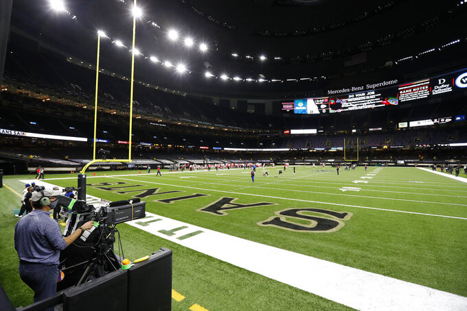 FILE - In this Sunday, Dec. 20, 2020, file photo, a cameraman shoots from the end zone of an NFL football game between the New Orleans Saints and the Kansas City Chiefs, in New Orleans. Plans for $450 million in upgrades to New Orleans' iconic Superdome have been disrupted because of financial troubles caused by the pandemic. (AP Photo/Tyler Kaufman, File)