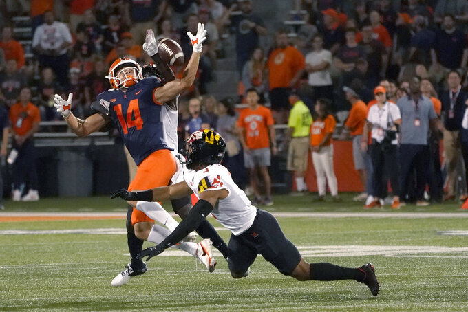 Maryland defensive back Jakorian Bennett, behind, breaks up a pass intended for Illinois wide receiver Casey Washington as Nick Cross also defends during the first half of an NCAA college football game Friday, Sept. 17, 2021, in Champaign, Ill. (AP Photo/Charles Rex Arbogast)
