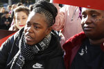 Tolani King, left, cries next to Sharena Thomas, both from the group Moms 4 Housing, as they talk with Oakland Mayor Libby Schaaf at a rally outside of City Hall in Oakland, Calif., Tuesday, Jan. 7, 2020. Some California lawmakers said they support a group of homeless women who have been illegally living in a vacant three-bedroom house since November, partly to protest real estate speculators who drive up housing costs in the pricey San Francisco Bay Area. (AP Photo/Jeff Chiu)