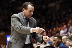Duke head coach Mike Krzyzewski speaks with his players during the first half of an NCAA college basketball game against Florida State in Durham, N.C., Monday, Feb. 10, 2020. (AP Photo/Gerry Broome)