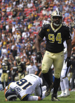 New Orleans Saints defensive end Cameron Jordan, right, celebrates after sacking Los Angeles Rams quarterback Jared Goff during the first half of an NFL football game Sunday, Sept. 15, 2019, in Los Angeles. (AP Photo/Mark J. Terrill)