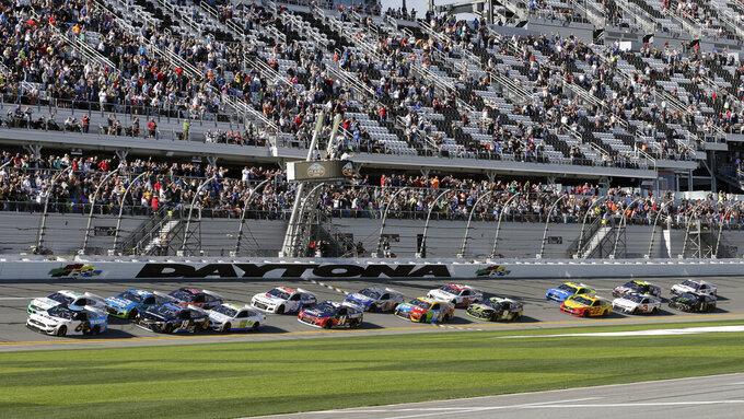 Ryan Newman (6) and Brad Keselowski, front left, lead the field to start the NASCAR Busch Clash auto race at Daytona International Speedway, Sunday, Feb. 9, 2020, in Daytona Beach, Fla. (AP Photo/Terry Renna)
