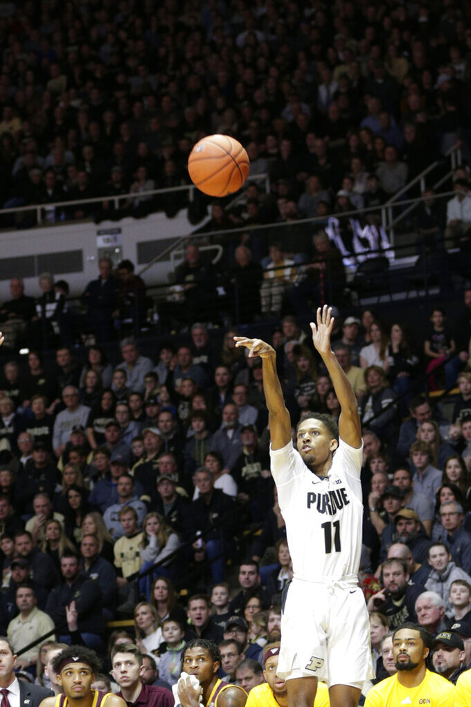 Purdue guard Isaiah Thompson (11) goes up for three during the first half of an NCAA college basketball game in West Lafayette, Ind., Saturday, Dec. 28, 2019. (Nikos Frazier/Journal & Courier via AP)