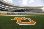 """FILE - In this Aug. 18, 2014, file photo, the Baylor University logo is displayed on the football field at McLane Stadium in Waco, Texas. The NCAA infractions committee said Wednesday, Aug. 11, 2021, that its years-long investigation into the Baylor sexual assault scandal would result in four years probation and other sanctions, though the """"unacceptable"""" behavior at the heart of the case did not violate NCAA rules. (AP Photo/Waco Tribune-Herald via AP, File)"""