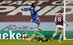 Aston Villa's goalkeeper Emiliano Martinez makes a save during the English Premier League soccer match between Aston Villa and Brighton and Hove Albion at Villa Park stadium in Birmingham, England. Saturday, Nov. 21, 2020. (Tim Keeton/Pool via AP)