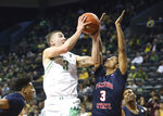 Oregon's Payton Pritchard, left, shots over Fresno State's Jarred Hyder during the first half of an NCAA college basketball game in Eugene, Ore., Tuesday, Nov. 5, 2019. (AP Photo/Chris Pietsch)