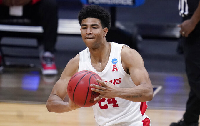 FILE - In this March 27, 2021, file photo, Houston guard Quentin Grimes passes the ball against Syracuse in the second half of an NCAA men's college basketball tournament game in Indianapolis. Grimes was selected in the first round of the NBA draft Thursday, July 29. (AP Photo/Michael Conroy, File)