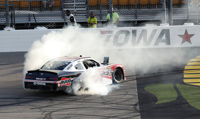 Christopher Bell does a burnout after winning a NASCAR Xfinity Series auto race, Sunday, June 16, 2019, at Iowa Speedway in Newton, Iowa. (AP Photo/Charlie Neibergall)
