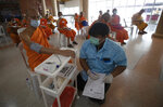 A health worker checks blood pressure of a Buddhist monk who received AstraZeneca COVID-19 vaccine for side effects at Nak Prok Temple in Bangkok, Thailand, Friday, April 9, 2021. (AP Photo/Sakchai Lalit)