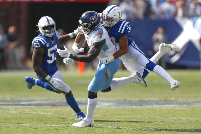 Indianapolis Colts cornerback Quincy Wilson (31) breaks up a pass intended for Tennessee Titans wide receiver A.J. Brown (11) to end the Titans' final drive in the final seconds of the fourth quarter of an NFL football game Sunday, Sept. 15, 2019, in Nashville, Tenn. (AP Photo/Wade Payne)