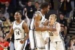 Vanderbilt guard Drew Weikert (10) celebrates with Ejike Obinna, center, after Weikert scored against Georgia in the first half of an NCAA college basketball game Saturday, Feb. 22, 2020, in Nashville, Tenn. (AP Photo/Mark Humphrey)