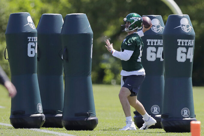 New York Jets quarterback Sam Darnold runs a drill at the team's NFL football training facility in Florham Park, N.J., Tuesday, June 4, 2019. (AP Photo/Julio Cortez)