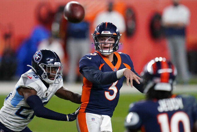 Denver Broncos quarterback Drew Lock (3) throws under pressure from Tennessee Titans cornerback Kristian Fulton (26) during the second half of an NFL football game, Monday, Sept. 14, 2020, in Denver. (AP Photo/Jack Dempsey)