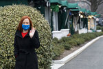 White House press secretary Jen Psaki waves after doing a television interview at the White House, Thursday, Jan. 21, 2021, in Washington. (AP Photo/Alex Brandon)