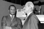 FILE - In this Jan. 3, 1970, file photo, baseball player Curt Flood, left, and Marvin Miller, executive director of the Major League Baseball Players Association, wait inside ABC Television Studio before an appearance in New York. Ahead of Miller's induction Wednesday into the Hall of Fame, union leaders say his philosophies and strategies still make up the union's foundation.  (AP Photo/File)