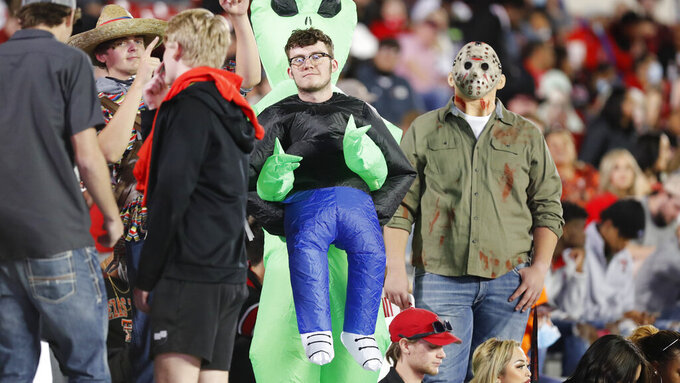 Texas Tech students wear Halloween costumes during an NCAA college football game between Texas Tech and Oklahoma, Saturday, Oct. 31, 2020, in Lubbock, Texas. (AP Photo/Mark Rogers)