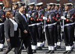 Italian Defense Minister Elisabetta Trenta and Chinese President Xi Jinping review the honor guard during his visit the Monument of the Unknown Soldier, in Rome, Friday, March 22, 2019. Jinping is launching a two-day official visit aimed at deepening economic and cultural ties with Italy through an ambitious infrastructure building program called