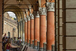 A view of Bologna's porticoes in Bologna, Italy,  Wednesday, July 28, 2021. Bologna's 12th-century porticoes, still part of the city's everyday life, have been added to the World Heritage List. At a meeting in China on Wednesday, the World Heritage Committee of UNESCO, the U.N. culture agency, inscribed the porticoes on the prestigious list. The addition raises to 58 the number of Italian sites on the list. (Guido Calamosca/LaPresse via AP)