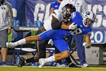 Troy safety Dell Pettus (31) tackles BYU wide receiver Gunner Romney during the first half during an NCAA college football game Saturday, Sept. 26, 2020, in Provo, Utah. (AP Photo/Rick Bowmer, Pool)