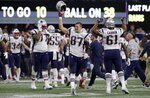 "FILE - In this Feb. 3, 2019, file photo, New England Patriots' Rob Gronkowski (87) celebrates with teammates after the NFL Super Bowl 53 football game against the Los Angeles Rams in Atlanta. The Patriots won 13-3. Gronkowski says he is retiring from the NFL after nine seasons. Gronkowski announced his decision via a post on Instagram Sunday, March 24, 2019, saying that a few months shy of this 30th birthday ""its time to move forward and move forward with a big smile."" (AP Photo/Carolyn Kaster, File)"