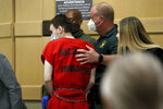 Parkland school shooter Nikolas Cruz is escorted from the courtroom following a pre-trial hearing at the Broward County Courthouse in Fort Lauderdale, Fla., Wednesday, July 14, 2021, on four criminal counts stemming from his alleged attack on a Broward jail guard in November 2018. Cruz is accused of punching Sgt. Ray Beltran, wrestling him to the ground and taking his stun gun. (Amy Beth Bennett/South Florida Sun-Sentinel via AP, Pool)