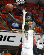 Iowa State guard Marial Shayok shoots as Oklahoma State guard Thomas Dziagwa (4) defends duering the second half of an NCAA college basketball game in Stillwater, Okla., Wednesday, Jan. 2, 2019. (AP Photo/Sue Ogrocki)