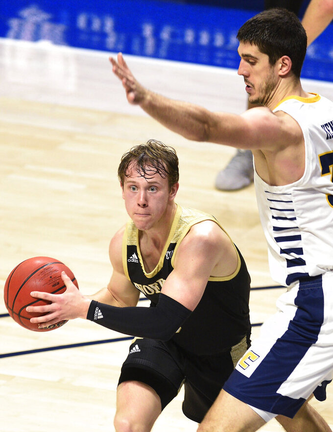 Wofford's Storm Murphy (5) looks to pass the ball while Chattanooga's Stefan Kenic (33) defends during an NCAA college basketball game Wednesday, Jan. 15, 2020, in Chattanooga, Tenn. (Robin Rudd/Chattanooga Times Free Press via AP)