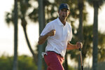 Stewart Hagestad, of the USA team, celebrates after a putt on the 15th hole in the singles matches during the Walker Cup golf tournament at the Seminole Golf Club on Sunday, May 9, 2021, in Juno Beach, Fla. (AP Photo/Gerald Herbert)