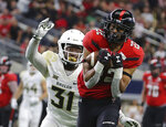 Texas Tech wide receiver Seth Collins (22) catches a pass against Baylor cornerback Harrison Hand (31) in the first half of an NCAA college football game Saturday, Nov. 24, 201 in Arlington, Texas. (Jerry Larson/Waco Tribune-Herald via AP)