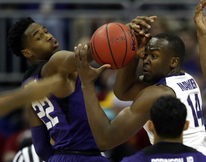 Kansas State forward Makol Mawien (14) rebounds against TCU guard RJ Nembhard (22) during the second half of an NCAA college basketball game in the quarterfinals of the Big 12 conference tournament in Kansas City, Mo., Thursday, March 14, 2019. (AP Photo/Orlin Wagner)
