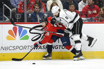 Washington Capitals left wing Brendan Leipsic (28) and Los Angeles Kings defenseman Drew Doughty (8) compete for the puck during the first period of an NHL hockey game Tuesday, Feb. 4, 2020, in Washington. (AP Photo/Nick Wass)