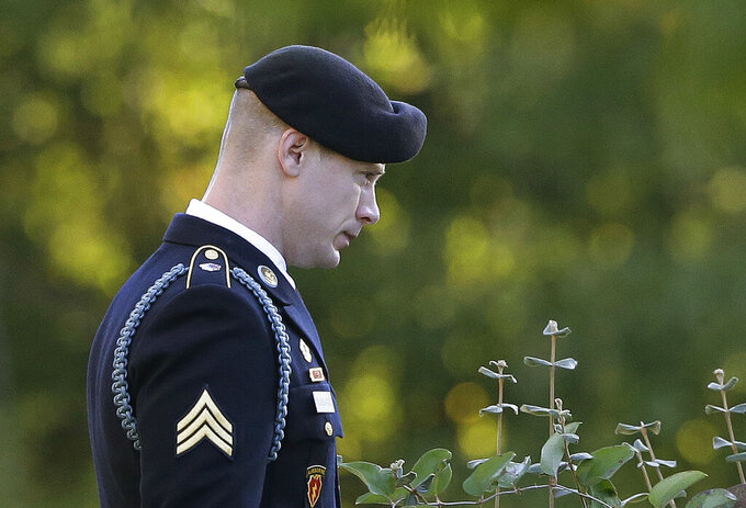 FILE - In this Nov. 3, 2017, file photo, Army Sgt. Bowe Bergdahl leaves the Fort Bragg courtroom facility during deliberations at a sentencing hearing in Fort Bragg, N.C.  Bergdahl, who was court martialed after he left his post and was captured by the Taliban is asking a federal judge to overturn his military conviction, saying his trial was unduly influenced when former President Donald Trump repeatedly made disparaging comments about him and called for his execution. (AP Photo/Gerry Broome, File)