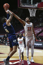 Georgia Tech's Jordan Usher (4) shoots over Virginia Tech's Keve Aluma (22) during the second half of an NCAA college basketball game Tuesday, Feb. 23, 2021, in Blacksburg, Va. (Matt Gentry/The Roanoke Times via AP, Pool)
