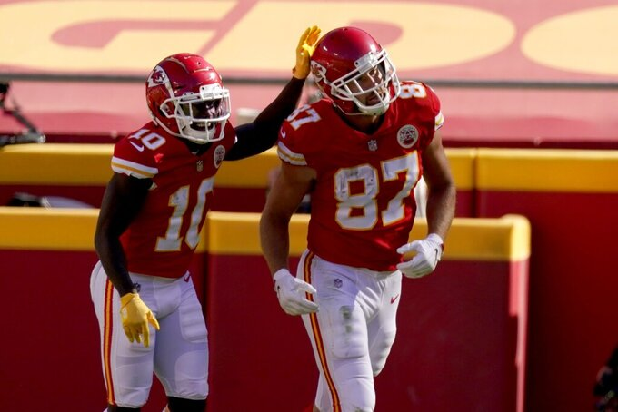Kansas City Chiefs' Tyreek Hill (10) and Travis Kelce (87) celebrate a touchdown scored by Kelce in the first half of an NFL football game against the New York Jets on Sunday, Nov. 1, 2020, in Kansas City, Mo. (AP Photo/Charlie Riedel)