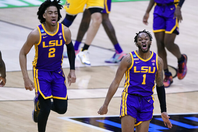 LSU guard Javonte Smart (1) celebrates with teammate Trendon Watford (2) during the first half of a second-round game against Michigan in the NCAA men's college basketball tournament at Lucas Oil Stadium Monday, March 22, 2021, in Indianapolis. (AP Photo/Darron Cummings)