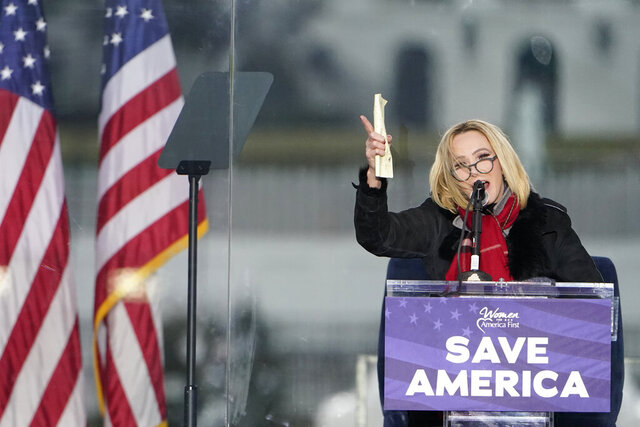 FILE - In this Wednesday, Jan. 6, 2021 file photo, Pastor Paula White leads a prayer in Washington, at a rally in support of President Donald Trump called the