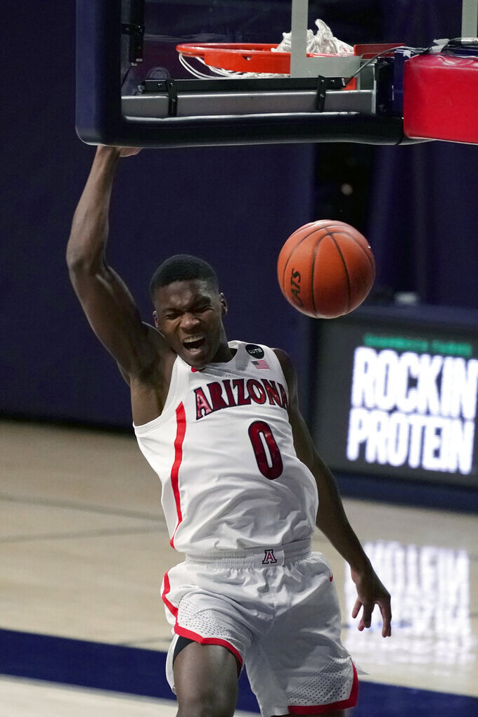 Arizona guard Bennedict Mathurin (0) dunks against Arizona State during the first half of an NCAA college basketball game, Monday, Jan. 25, 2021, in Tucson, Ariz. (AP Photo/Rick Scuteri)
