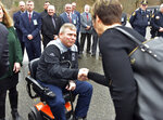 In this Dec. 10, 2019 photo, Lee, Mass. Police Chief Jeffrey Roosa, who has amyotrophic lateral sclerosis, also known as ALS, shakes hands with the late Judge William Boyle's widow, Rose Boyle, after Roosa was presented with a wheelchair van in Holyoke, Mass. The Boyle family donated the van formerly used by Judge Boyle, who died from the same disease. (Don Treeger/The Republican via AP)