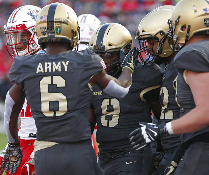 Army quarterback Luke Langdon (9) celebrates his touchdown with wide receiver Glen Coates (6) against Houston during the first half of Armed Forces Bowl NCAA college football game Saturday, Dec. 22, 2018, in Fort Worth, Texas. (AP Photo/Jim Cowsert)