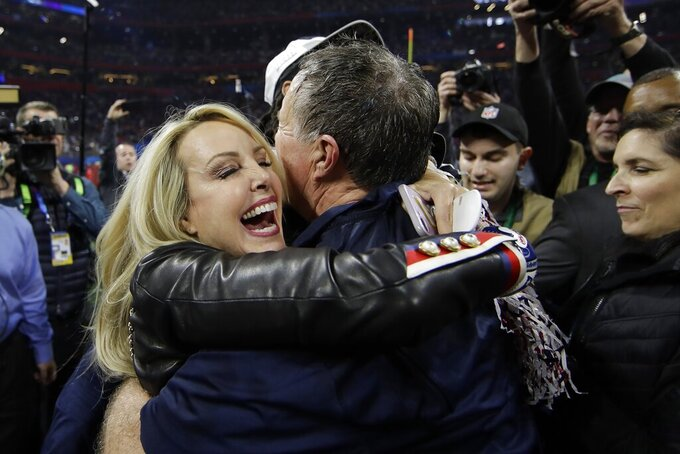 Linda Holliday hugs New England Patriots head coach Bill Belichick, after the NFL Super Bowl 53 football game against the Los Angeles Rams, Sunday, Feb. 3, 2019, in Atlanta. The Patriots won 13-3. (AP Photo/Matt Rourke)