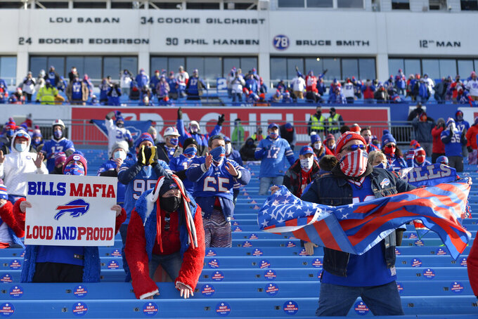 Buffalo Bills fans cheer during the first half of an NFL wild-card playoff football game against the Indianapolis Colts, Saturday, Jan. 9, 2021, in Orchard Park, N.Y. (AP Photo/Adrian Kraus)